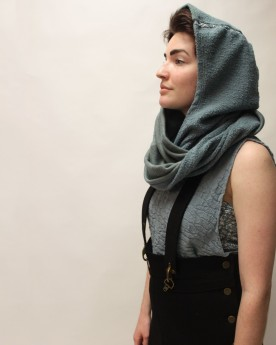 Detail shot of seamless knit, textured tank top, hooded scarf, and high wasted pant